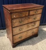 An oak chest in the early 18th Century manner, the plain top over two short and three long walnut