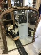 A Victorian gilt and gesso framed dome top overmantel mirror, 95 cm wide x 116.5 cm high