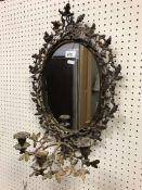 A 19th Century gilt brass oak leaf and acorn framed girandole mirror with three branch like