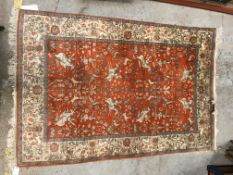 A Tabriz carpet, the central panel set with all-over figural and animal decoration including