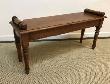 An oak window seat in the Victorian manner, the single plank top with moulded edge and scroll