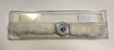 """A circa 1995 Swatch """"Seal"""" watch, the face inscribed """"I heart u"""" with faux fur strap in Atlanta 1996"""