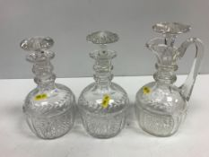 A pair of 19th Century facet and foliate cut mallet-shaped decanters with two ring neck and