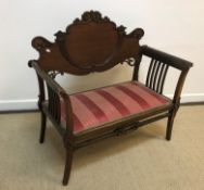 An Edwardian mahogany framed two seat salon settee with applied carved decoration, 92 cm wide x 45