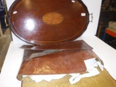 An Edwardian mahogany and fan marquetry inlaid two handled drinks' tray of oval form with brass