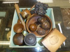 A quantity of various treen ware to include carved beetelnut egg-shaped pomander, small dried
