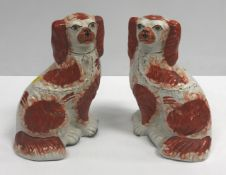 A collection of Staffordshire pottery to include a pair of hollow bottom Fallow Deer bocage figures,