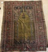 A late 19th Century Ghiordis, West Anatolia silk prayer rug with Mirhab design on a green ground,
