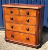 A Victorian mahogany chest, the top with moulded edge over two short and three long graduated