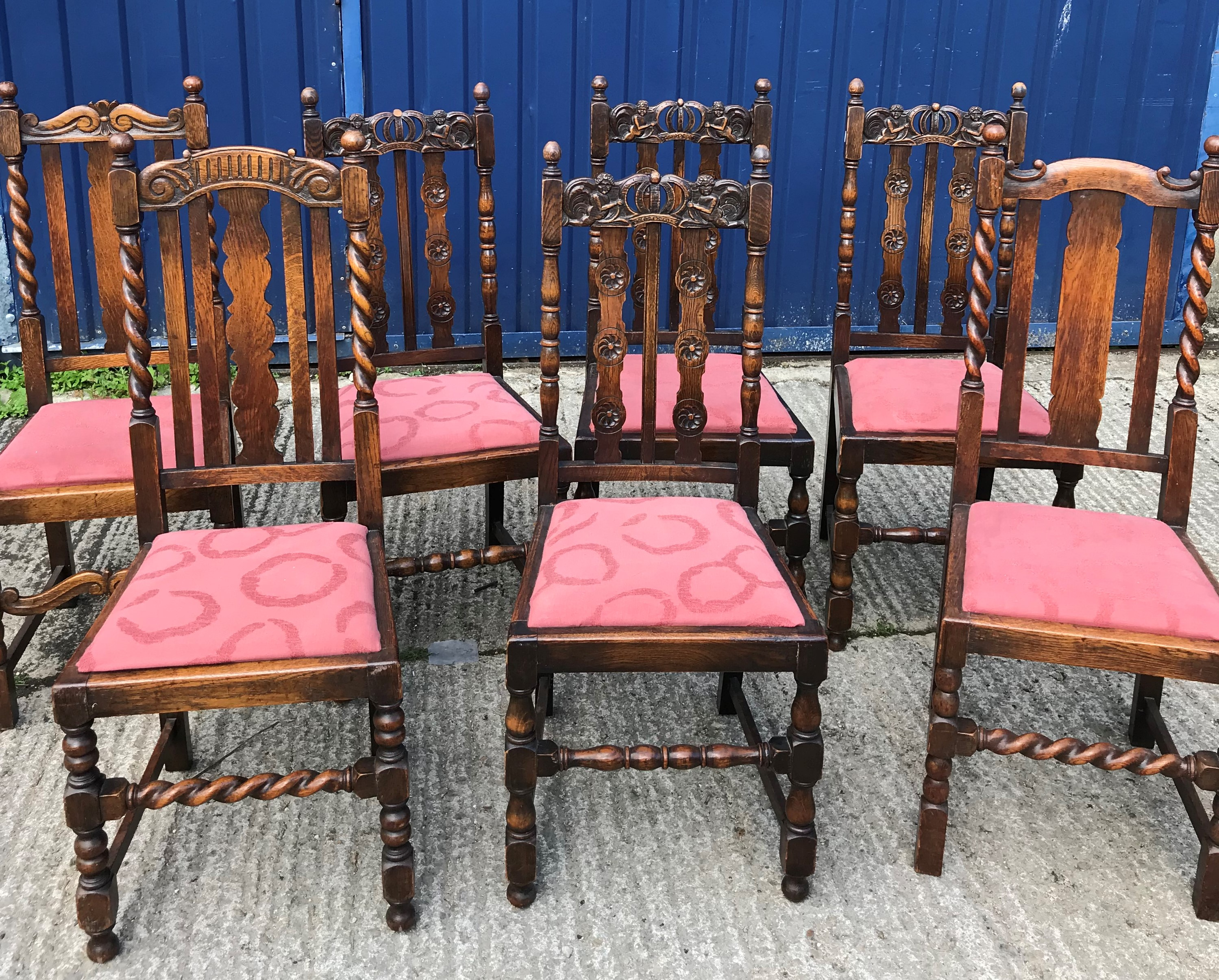 A set of four early 20th Century carved oak dining chairs in the Carolean taste and two similar with