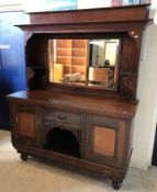 An Edwardian mahogany mirror back sideboard with drawer and two cupboard doors over two further