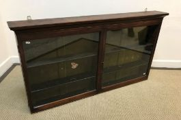 A circa 1900 mahogany hanging wall display cabinet with two plain glazed doors enclosing four