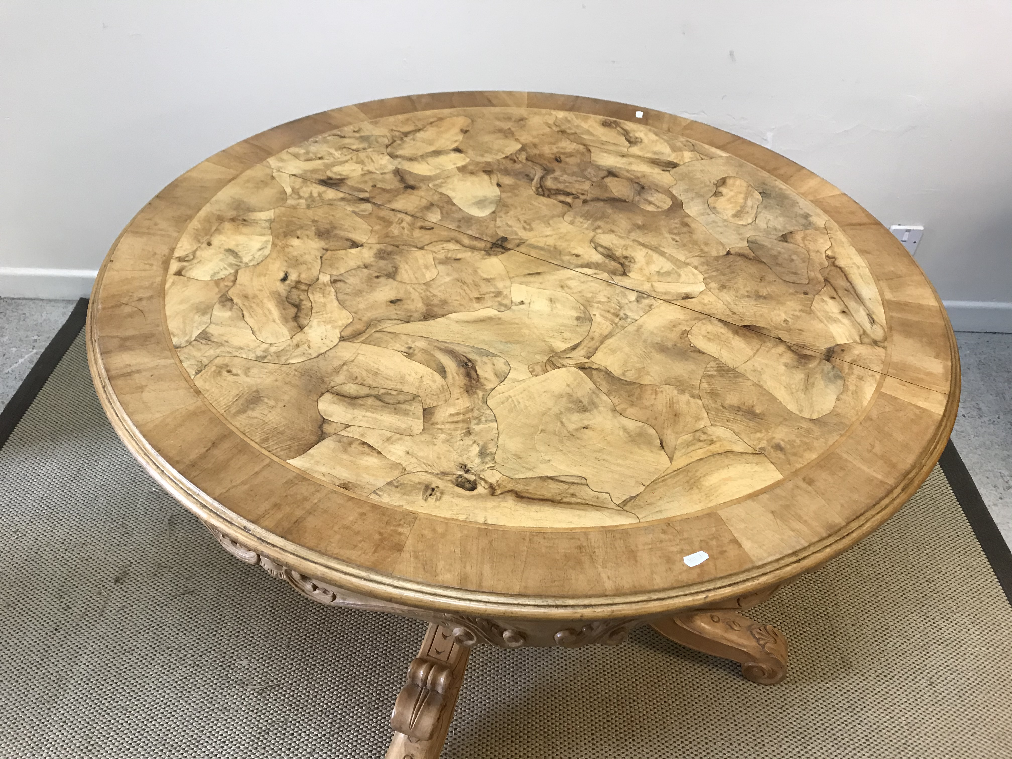 A modern Continental walnut dining table, the circular cross-banded top with moulded edge and - Image 2 of 2