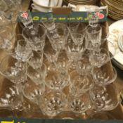 A collection of early 20th Century stem drinking glasses with facet cut bucket-shaped bowls,