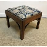 A 19th Century mahogany framed stool with floral needlework drop-in seat within a moulded edge, on