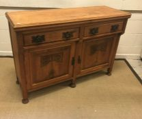 A Victorian carved oak sideboard or dresser, the plain top above two drawers and two cupboard