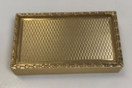 A 9 carat gold engine turned snuff box with sliding top and harebell banded edge by S.J. Rose &