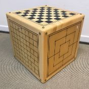 An Alison Henry game cube table each side with different games board together with games pieces 49