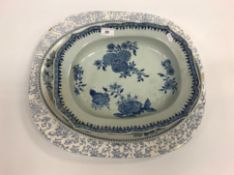 An 18th Century Chinese blue and white shaped rectangular platter with floral spray decoration to