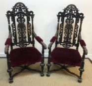 A pair of 19th Century oak and carved throne type chairs in the Carolean taste with upholstered