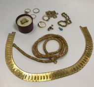 A collection of various costume jewellery to include 9 carat gold chainlink necklace set with ruby