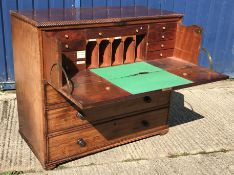 An early 19th Century mahogany and rosewood cross banded secretaire chest, the top with ropework