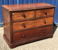 A Victorian mahogany chest, the top with applied moulded edge over two short and two long drawers