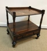 An early 19th Century rosewood four-tier whatnot, the three-quarter gallery top on turned and ringed