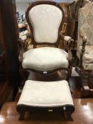 A Victorian moulded walnut framed shaped back salon open arm elbow chair on cabriole front legs to