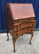 An early to mid 20th Century burr walnut veneered bureau in the 18th Century Dutch taste 51 cm