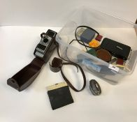 A collection of various items to include a Bell & Howell 624EE Auto Set cine camera, a Baldur