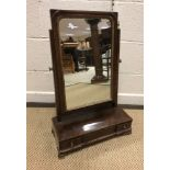 A 19th Century mahogany toilet mirror, the rectangular plate on a three drawer base with ogee