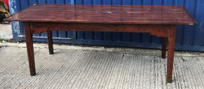 A 19th Century French stained pine farmhouse kitchen table, the four plank top with cleated ends