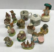 A collection of eleven Beatrix Potter figurines comprising a Beswick brown back stamp Jeremy