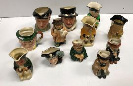 A collection of twelve various Doulton, Tony Wood, Sylvac and other character and Toby jugs