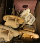 Four various vintage cream plastic telephones, together with a vintage Pifco Princess Whisper