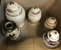 A collection of four modern ginger-style jars with various decoration, to include a graduated set of