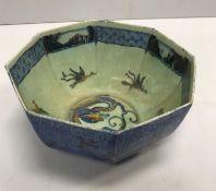 A Wedgwood blue round dragon decorated bowl of octagonal form 9 cm high