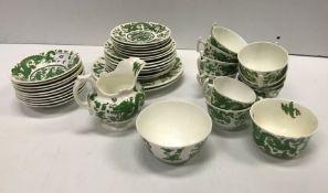 A Coalport green five toed dragon decorated tea set (10 place settings)