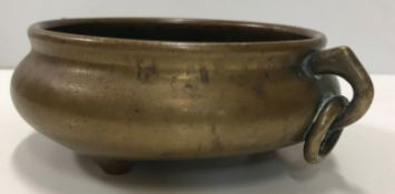 A Chinese bronze censer of small proportions, the