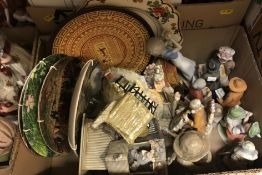 Four boxes of assorted ornamental figures and a box of assorted collectors' plates