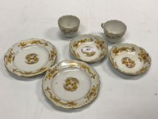 A Meissen golden dragon decorated teawares comprising a pair of trios