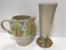 A Clarice Cliff Wilkinson trumpet shaped vase on floral decorated relief work base 27 cm high