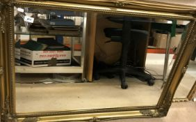 A modern gilt framed mirror with bevelled edge, 105 cm x 75.5 cm, together with another smaller