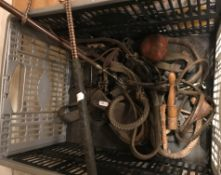 A collection of various equestrian items to include tack, lunging whip, old leather stirrup, etc,