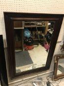 A modern mahogany framed rectangular wall mirror with bevelled edge, 110 cm x 80 cm