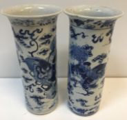 A pair of 19th Century blue and white Chinese cyli