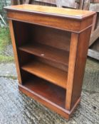 A mahogany bookcase in the Victorian manner with two adjustable shelves, on a plinth base, 74 cm