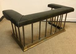 A club fender with green leather top on brass base, 116 cm wide x 57 cm deep x 51 cm high (