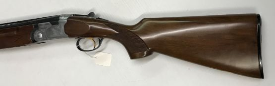 A Beretta S/G 12 bore shotgun, over and under, the side plates engraved with Spaniel to one side and
